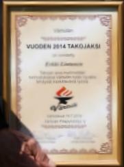 VUODEN 2014 TAKOJAN kunniakirja Erkki Lintusen käsissä.